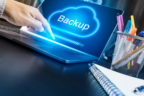 Businessman hand using modern laptop with Cloud Backup concept.Technology online connection.online data base.