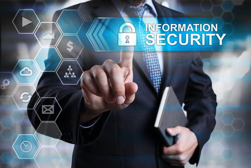 Information security concept. Businessman pointing on virtual screen with text and icons.