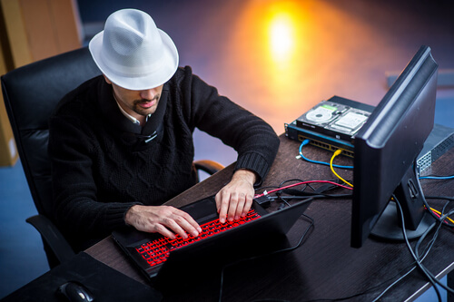 White hatter ethical hacker working on a computer network