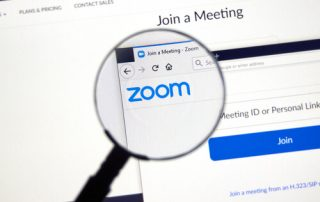 Montreal, Canada - March 22, 2020: Zoom official website and logo. Zoom Communications is remote conferencing services company. It provides a remote conferencing services like meetings, calls, chat