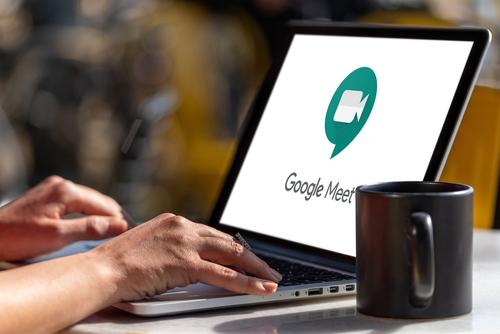 Computer showing Google Meet app logo.